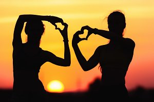 Silhouette of girls with heart shape