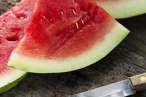 pieces of watermelon on wooden background