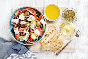 Greek salad with glass of white wine