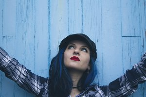 young woman in blue wall