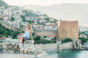 Woman sitting on fortress wall