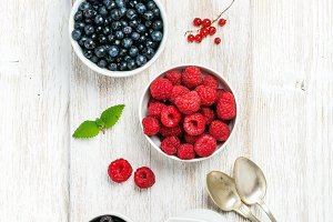 Fresh garden berries in bowls