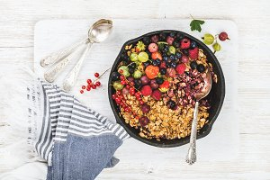 Oat granola crumble with fresh garden berries and seeds
