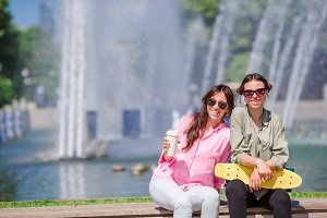 Happy young urban girls in european city. Caucasian tourists having fun together outdoors
