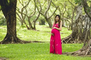 Pretty asian pregnant woman