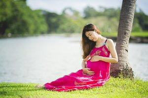 Pretty asian pregnant woman