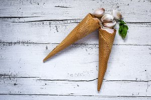 Garlic in waffle cone with mint