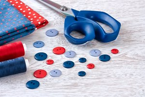scissors, threads, fabric,  buttons