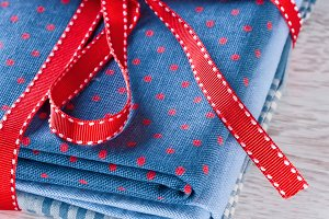 Blue fabric pile with red ribbon