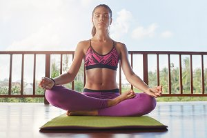 Beautiful female model meditating