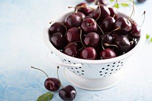 Fresh ripe sweet cherries in a colander