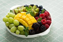 Fruit plate with berries, mango and kiwi