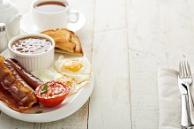 Full english breakfast with egg and bacon