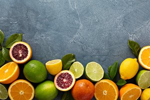 Citrus fruits background with oranges, limes and lemons