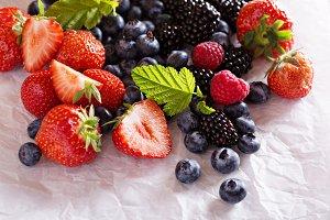 Variety of fresh berries on white