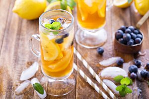Iced tea with blueberries and lemon slices