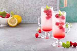 Pink raspberry lemonade in tall glasses