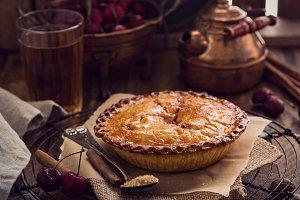 Cherry pie on rustic background