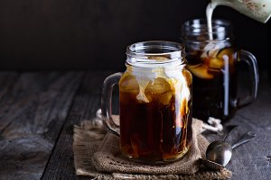 Iced coffee with milk in mason jars
