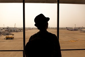 Silhouette of Traveler in Airport, waiting for the flight
