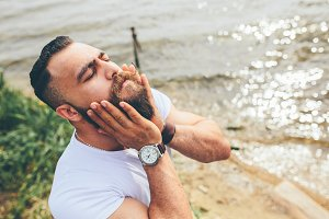 American Bearded Man touching his beard