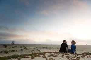 Engagement Couple Sitting on Beach