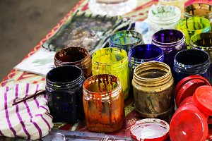 old watercolor paints and brushes for painting sculptures