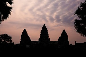 Silhouette of Angkor Wat with altocumulus clouds in twilight evening