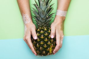Pineapple in lady's hands