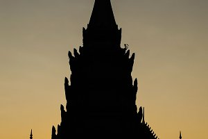 Silhouette of Buddhist Temple in Asia during sunset