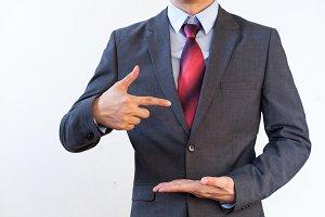 Businessman presenting something on white isolated background