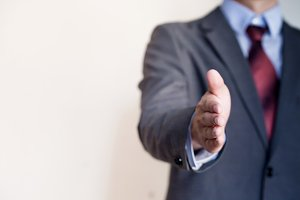 Business man reaching out hand to shake - Business Concept and Greeting