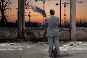 Businessman looking industrial place