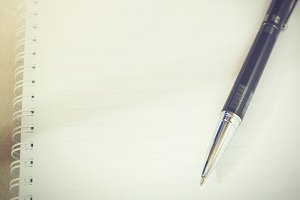 Ballpoint pen on blank sheet notebook (Vintage tone)