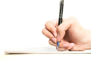 Hands with pen on notebook isolated on white background