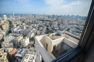 Panoramic view on roofs of  Tel-Aviv on the modern buildings background