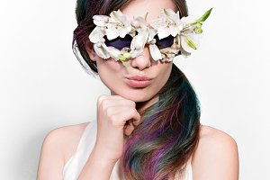 Beauty funny model woman in unusual sunglasses with color wavy hairstyle. Fashion shiny highlighter on skin, gloss lips make-up