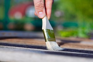 Paint brush on wooden table