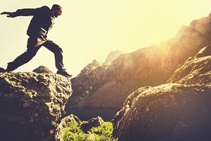 Man running on Mountains jumping