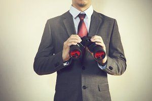 Businessman looking for something with binoculars such as business opportunities / jobs / new market - business issues discovery concept