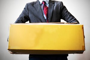 Business man carrying an old box with hard work - empty box ready to fill in text - business work,debt, too much work and burden concept