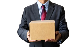 Young business man carrying empty box (with clipping path)