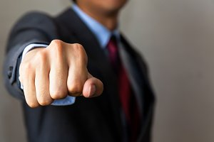 Businessman raising up his fist forward - it can be fist bump with friends / angry businessman