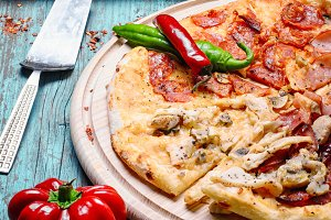 Pizza and baked vegetables