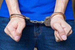 Handcuffed hands Closeup shot