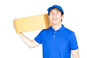Delivery man carries a cardboard package isolated on white background