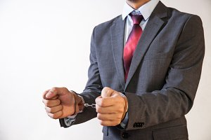 Business man criminal handcuffed - Business criminal, debt, burden concept