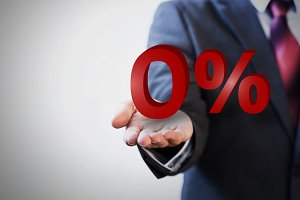 Businessman presenting zero percent graphic