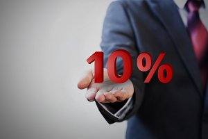 Businessman presenting ten percent graphic