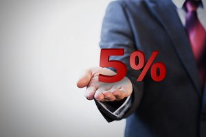 Businessman presenting five percent graphic